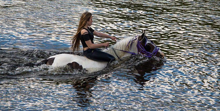 Girl riding horse at Appleby Horse Fair